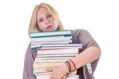 Carrying a big stack of books stock photography