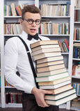 Carrying a book stack. Royalty Free Stock Images