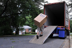 Carrying box into moving truck Stock Images