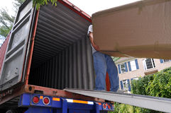 Carrying Boxes Into Moving Truck Stock Images