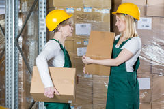Carrying the boxes Royalty Free Stock Photos