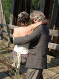 Carrying the bride. This groom is carrying the bride over an old railway trestle Stock Photo