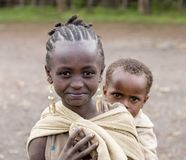 Carrying Brother In Ethiopia Royalty Free Stock Photography