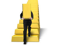 Carrying bullion climbing on gold stairs Royalty Free Stock Photography