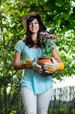 Carrying flowerpot Stock Image