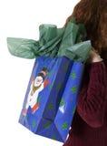 Carrying gift bag Stock Photos