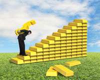 Carrying golden money symbol on gold stairs Stock Photo
