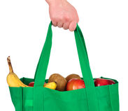 Carrying Groceries in Reusable Green Bag Stock Photos