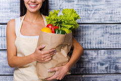 Carrying a healthy bag. Royalty Free Stock Images