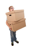 Carrying heavy packages. Boy holding a box, isolated over a white background Stock Image