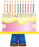 Carrying huge birthday cake Stock Photos