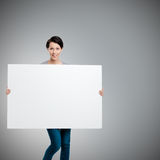 Carrying a huge sheet of white cardboard Stock Photo