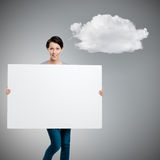 Carrying a huge sheet of white cardboard Royalty Free Stock Image