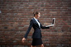 Carrying laptop Royalty Free Stock Photo