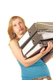 Carrying lots of files. A girl carrying a bunch of files. All isolated  on white background Stock Photos