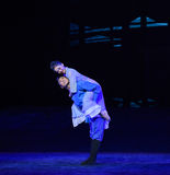 """Carrying a mother-Dance drama """"The Dream of Maritime Silk Road"""". Dance drama """"The Dream of Maritime Silk Road"""" centers on the plot of two stock photo"""
