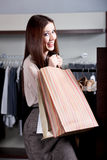 Carrying paper bags after successful purchase Stock Image