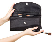 Carrying Pouch with brushes for make-up in female hands. stock photo