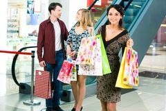 Carrying shopping bags Stock Photography