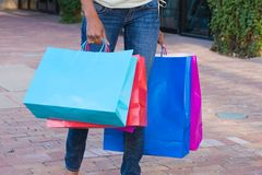 Carrying Shopping Bags Royalty Free Stock Photography
