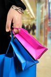 Carrying shopping bags in shopping centre Royalty Free Stock Photo