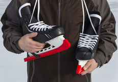 Carrying Skates with Guards Stock Photography