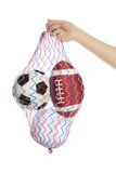 Carrying sport balls Royalty Free Stock Photo