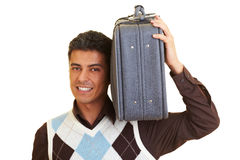 Carrying a suitcase Royalty Free Stock Image