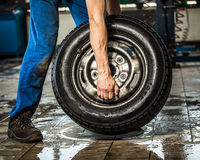 Carrying tires. Folding tire tire shop Stock Image