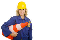 Carrying a traffic cone. Blonde female construction worker carrying a traffic cone stock photo
