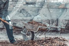 Carrying truck load of soil. Workers carrying truck load of soil Royalty Free Stock Photography