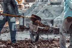 Carrying truck load of soil. Workers carrying truck load of soil Stock Photo