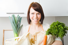 Carrying vegetables Stock Images
