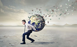 Carrying the whole world Stock Images