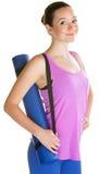 Carrying Yoga Mat夫人 图库摄影