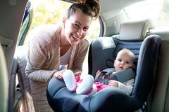 - Carrying your baby around in infant car seat stock photo