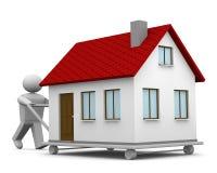 Carryng uma casa Foto de Stock Royalty Free