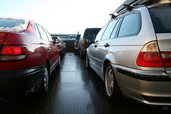 Cars. In line on a ferry crossing a sea royalty free stock images