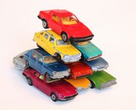 Cars. Pile of colorful toy cars isolated on white Stock Photography