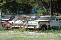 Cars. The Fords are just rusting away, now only good for scrap Stock Images