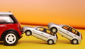 Cars. Toy cars hanging on each other Stock Photo