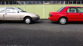 Cars. Two Cars parking in front of a Garage royalty free stock photo