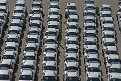 Cars. Columns of identical cars Royalty Free Stock Images