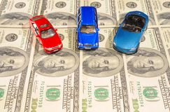 Cars. Three Toy Cars On One Hundred Dollar Bills Stock Photography