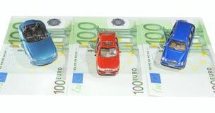 Cars. Three Toy Cars On One Hundred Euro Bills Stock Photos