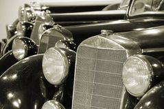 Cars. Four black antiquarian cars in garage Royalty Free Stock Photography