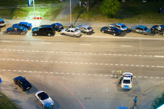 Cars along road and post of traffic police. Tyumen Royalty Free Stock Image