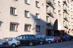 Cars & apartment building. Cars parked on the street in front of an apartment building in Vienna, Austria Royalty Free Stock Image