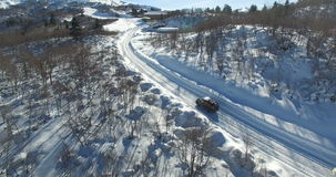 Cars approach the ski resort. Taken to drone in 4K stock footage