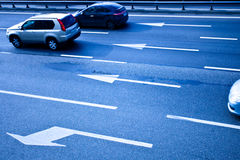 Cars on asphalt road with poits Stock Photography